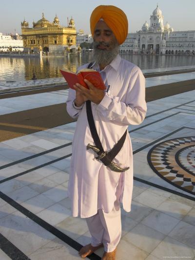Sikh Pilgrim with Orange Turban, White Dress and Dagger, Reading Prayer Book, Amritsar-Eitan Simanor-Photographic Print