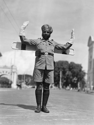 Sikh Traffic Policeman Standing in Middle of Street, Directing Traffic, Singapore-H^ Armstrong Roberts-Photographic Print