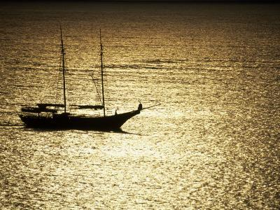 Silhouette of a Double Masted Sailboat on the Water-Michael Melford-Photographic Print