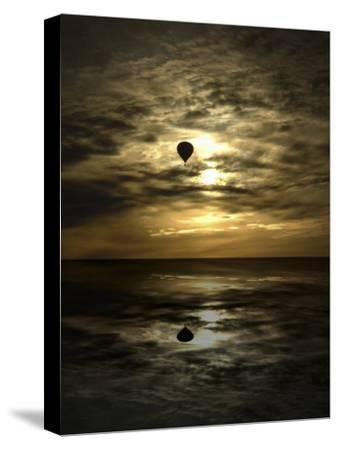 Silhouette of a Hot Air Balloon Over Water