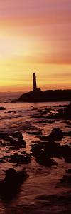 Silhouette of a Lighthouse at Sunset, Pigeon Point Lighthouse, San Mateo County, California, USA