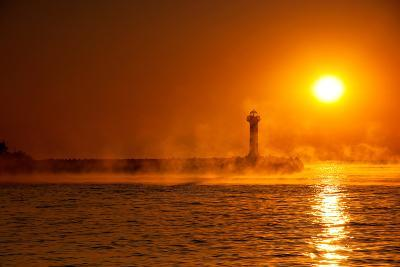 Silhouette of a Lighthouse in a Foggy Morning at Sunrise- jessivanova-Photographic Print