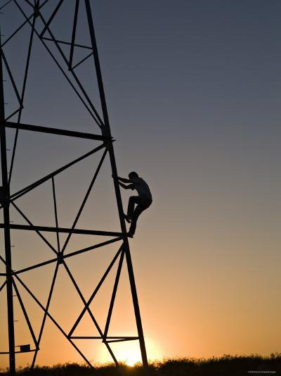 Silhouette of a Man Climbing a High Power Electric Line Tower, California-Dawn Kish-Photographic Print