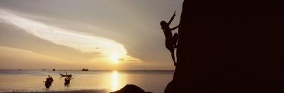 Silhouette of a Man Climbing a Rock, Railay Beach, Krabi, Thailand--Photographic Print