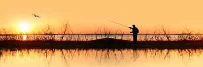 Silhouette of a Man Fishing--Photographic Print
