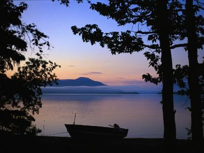 Silhouette of a Motor Boat on the Shores of a Bay in Alaska-Joel Sartore-Photographic Print