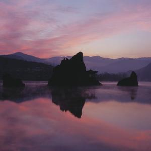 Silhouette of a Mountainous Landscape at Sunset