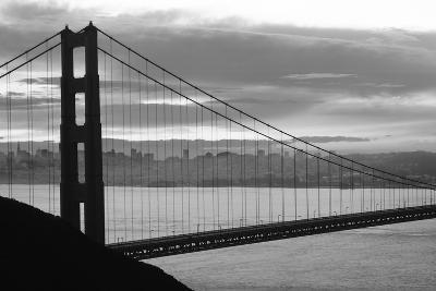 Silhouette of a suspension bridge at dusk, Golden Gate Bridge, San Francisco, California, USA--Photographic Print