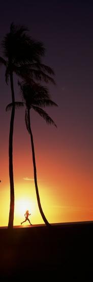 Silhouette of a Woman Running on the Beach, Magic Island, Hawaii, USA--Photographic Print