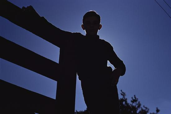 Silhouette of Boy Leaning Against Fence-William P^ Gottlieb-Photographic Print