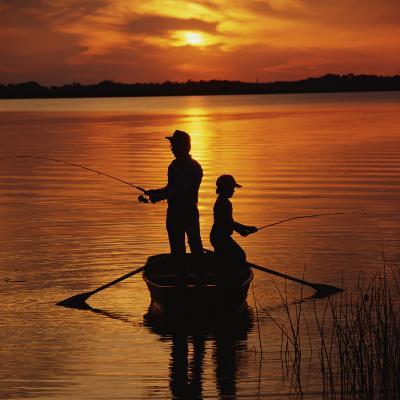 Silhouette of Father and Son Fishing at Sunset-Dennis Hallinan-Photographic Print