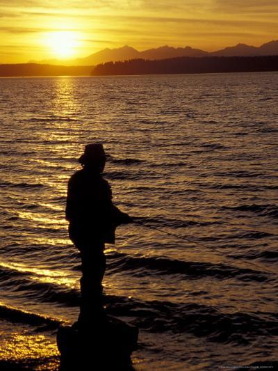 Silhouette of Fisherman at Lincoln Park, Seattle, Washington, USA-William Sutton-Photographic Print