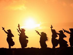 Silhouette of Hula Dancers at Sunrise, Molokai, Hawaii, USA
