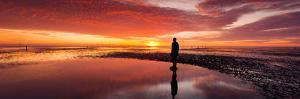 Silhouette of Human Sculpture on the Beach at Sunset, Another Place, Crosby Beach, Merseyside
