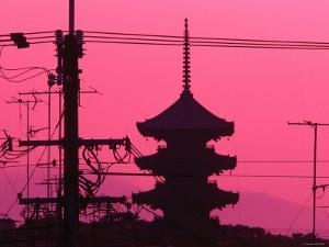 Silhouette of Japanese Architecture Behind Powerlines