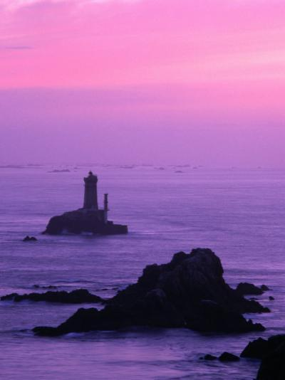 Silhouette of Lighthouse Against Pink Sky at Sunset, Pointe Du Raz, Brittany, France-Olivier Cirendini-Photographic Print