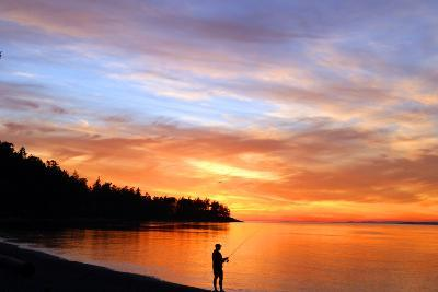 Silhouette of Man Fishing on West Beach on Whidbey Island-Donna O'Meara-Photographic Print