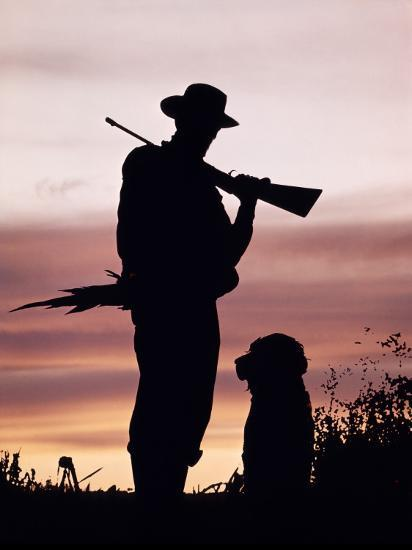 Silhouette of Man Hunter, Holding Rifle or Gun, Wearing Cowboy Hat-H^ Armstrong Roberts-Photographic Print
