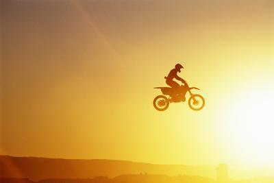 Silhouette of Motocross Race in mid Air, Sunset, Side View-John P Kelly-Photographic Print