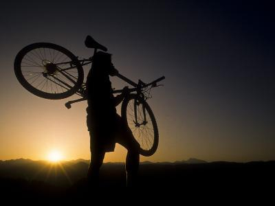 Silhouette of Mountain Biker at the Summit During Sunrise--Photographic Print