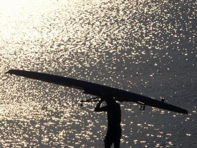 Silhouette of Rower Carrying His Boat, Vancouver Lake, Georgia, USA
