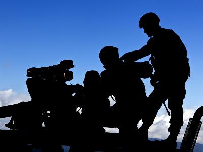 Silhouette of Soldiers Operating a BGM-71 Tow Guided Missile System-Stocktrek Images-Photographic Print