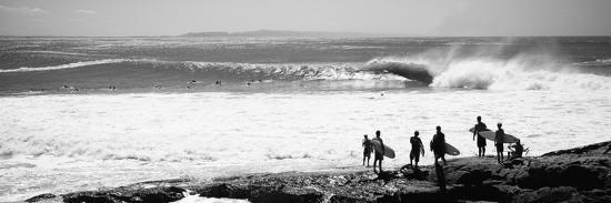 Silhouette of Surfers Standing on the Beach, Australia--Photographic Print