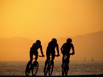 Silhouette of Three Men Riding on the Beach-Mitch Diamond-Photographic Print