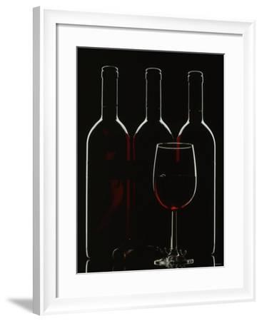 Silhouette of Three Red Wine Bottles and One Red Wine Glass-Walter Cimbal-Framed Photographic Print