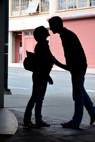Silhouette of Young Engaged Couple Bending Forward for a Kiss-Paul Damien-Photographic Print