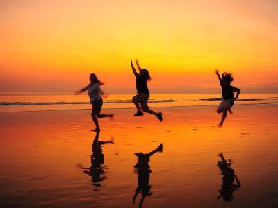 Silhouetted Children Playing on the Beach at Sunset-Jorge Fajl-Photographic Print