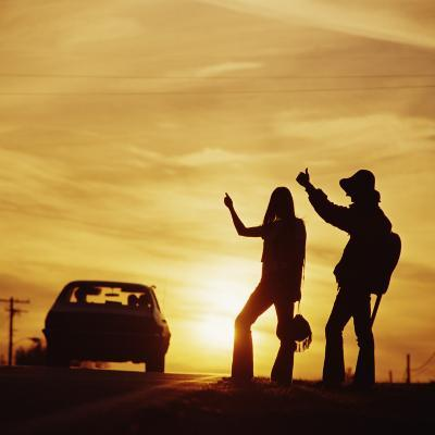 Silhouetted Couple Hitchhiking on Roadside-Dennis Hallinan-Photographic Print