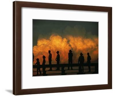 Silhouetted Fans Watch the Big Rodeo at Burwell in Central Nebraska-Joel Sartore-Framed Photographic Print