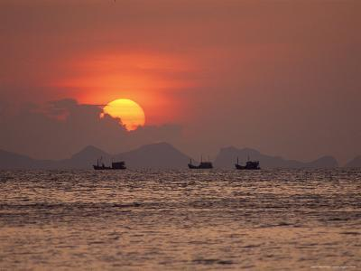 Silhouetted Fishing Boats on the Water at Sunset-Michael Melford-Photographic Print