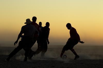 Silhouetted Men Playing Soccer at Sunset-Beverly Joubert-Photographic Print