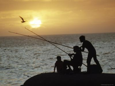 Silhouetted People Fish from the Shoreline near Montevideo, Montevideo, Uruguay-James L^ Stanfield-Photographic Print