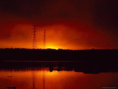 Silhouetted Power Lines at Sunrise Near a Calm Waterway-Heather Perry-Photographic Print