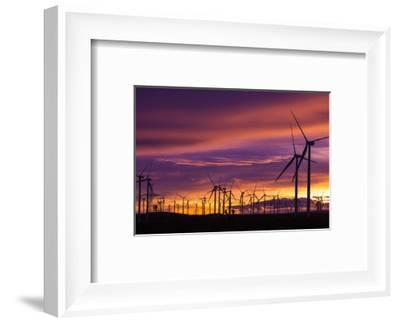 Silhouetted wind turbines at sunset, Mojave, California, USA-Russ Bishop-Framed Photographic Print