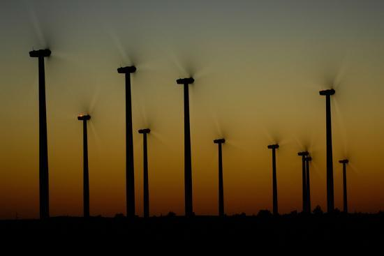 Silhouettes of a Windmills on a Wind Farm-Michael Forsberg-Photographic Print