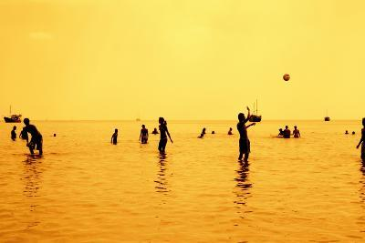 Silhouettes of People Playing Games in the Sea Full of Sailing-Ship-Dimitar Yalamov-Photographic Print