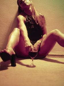 25-year-old Woman with Finger in a Glass of Wine by Silvestre Machado