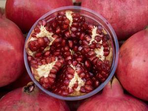 Pomegranates in Carmel St Market by Simon Foale