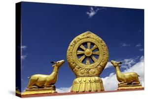 A Golden Dharma Wheel and Deer Sculptures by Simon Montgomery