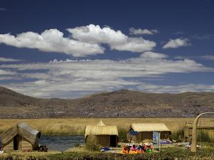 Floating Islands of Uros People, Traditional Reed Boats and Reed Houses, Lake Titicaca, Peru by Simon Montgomery