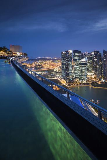 Singapore, Rooftop Swimming Pool at Dusk Overlooks the City-Walter Bibikow-Photographic Print