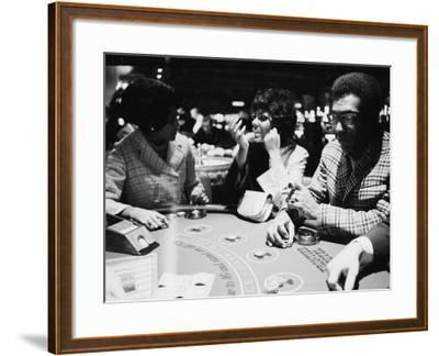 Singer Nancy Wilson, Actress Leslie Uggams, and Comedian Bill Cosby Playing Blackjack at the Sands