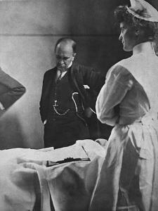 Sir William Osler Reading a Patient's Chart at Bedside as a Nurse Watches, Ca. 1903