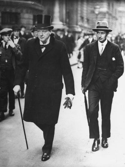 Sir Winston Churchill Walking in Street with Sir James Grigg, His Parliamentary Private Secretary--Photographic Print