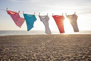 T-Shirts Hanging on a Clothesline at the Beach by Siri Stafford