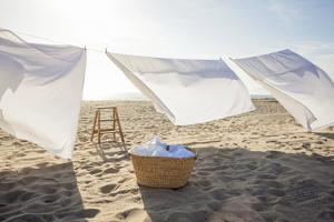 White Sheets Hanging on Laundry Line at Beach by Siri Stafford